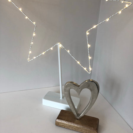 Heart ornament on wood stand