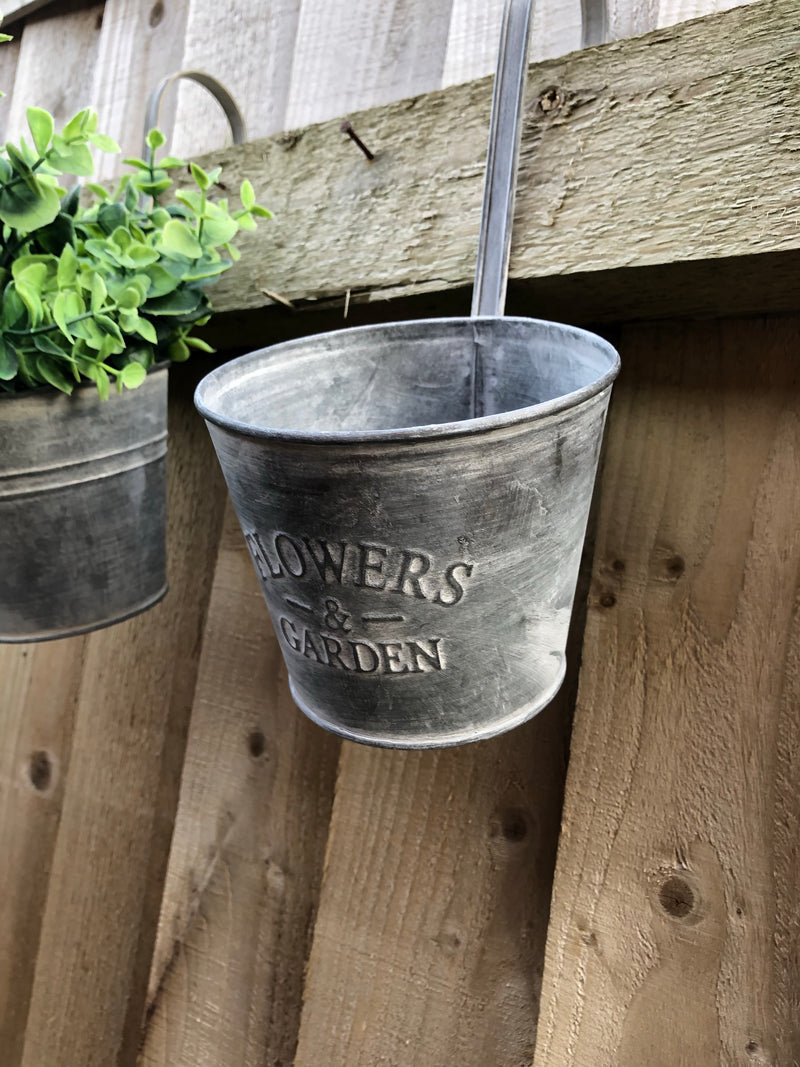 Metal hanging flower and garden embossed planter