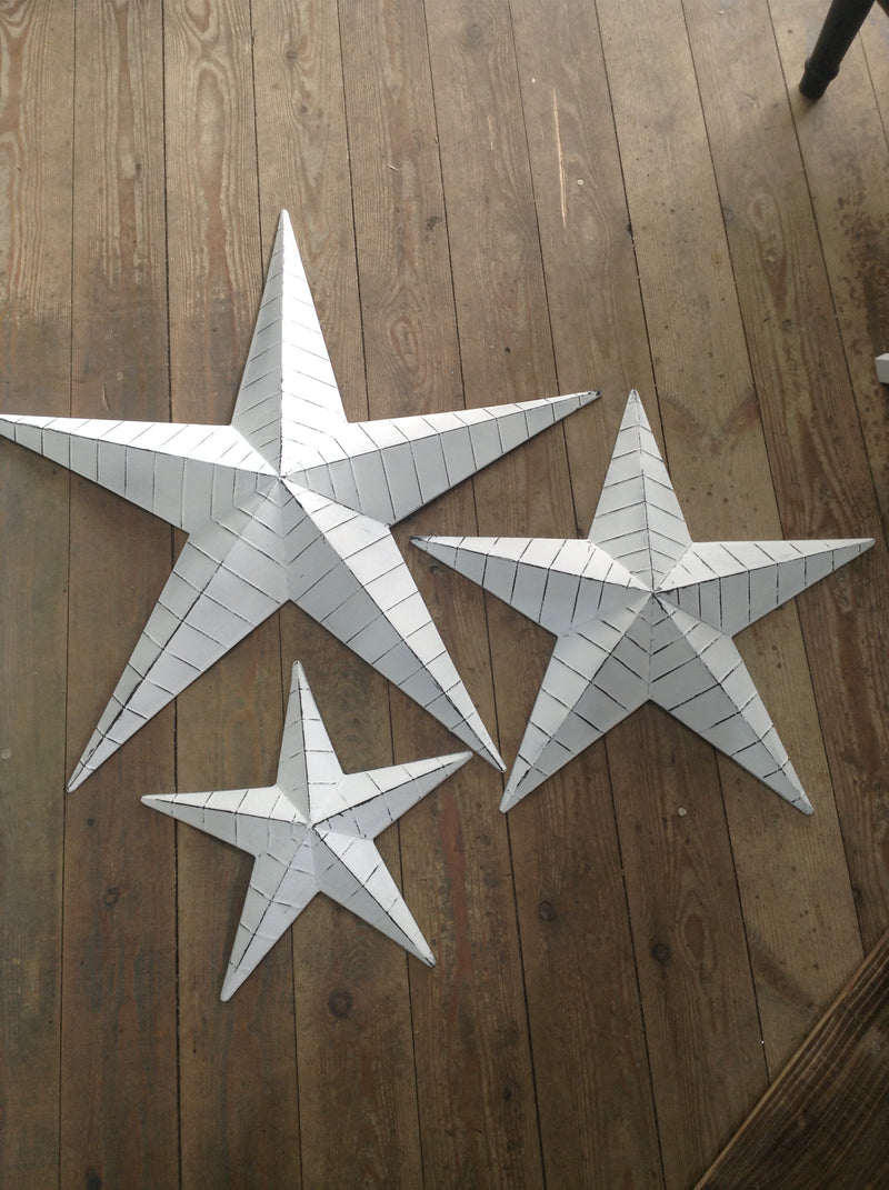 Small white lined metal barn star