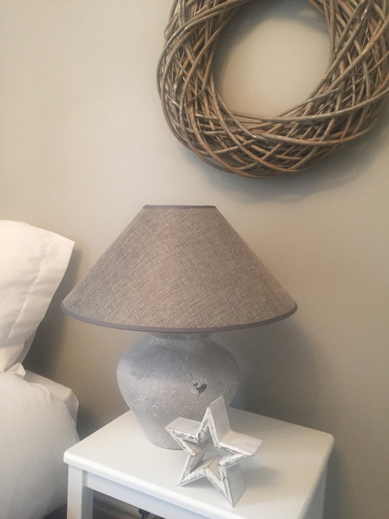White lamp with dark linen shade
