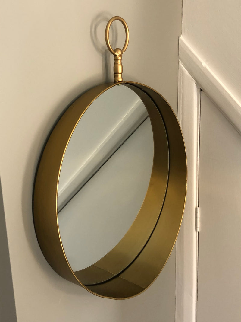 Round gold mirror with loop top