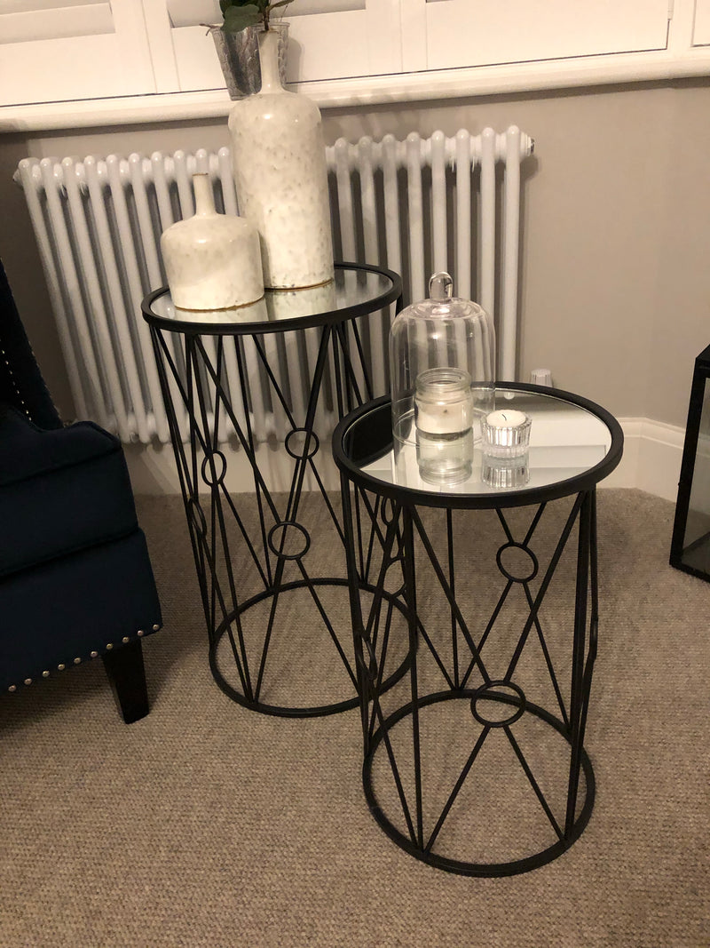 Small black metal table with mirrored top