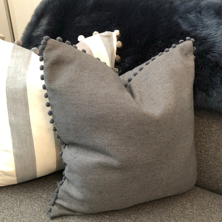 Large dark grey bobble Pom Pom cushion