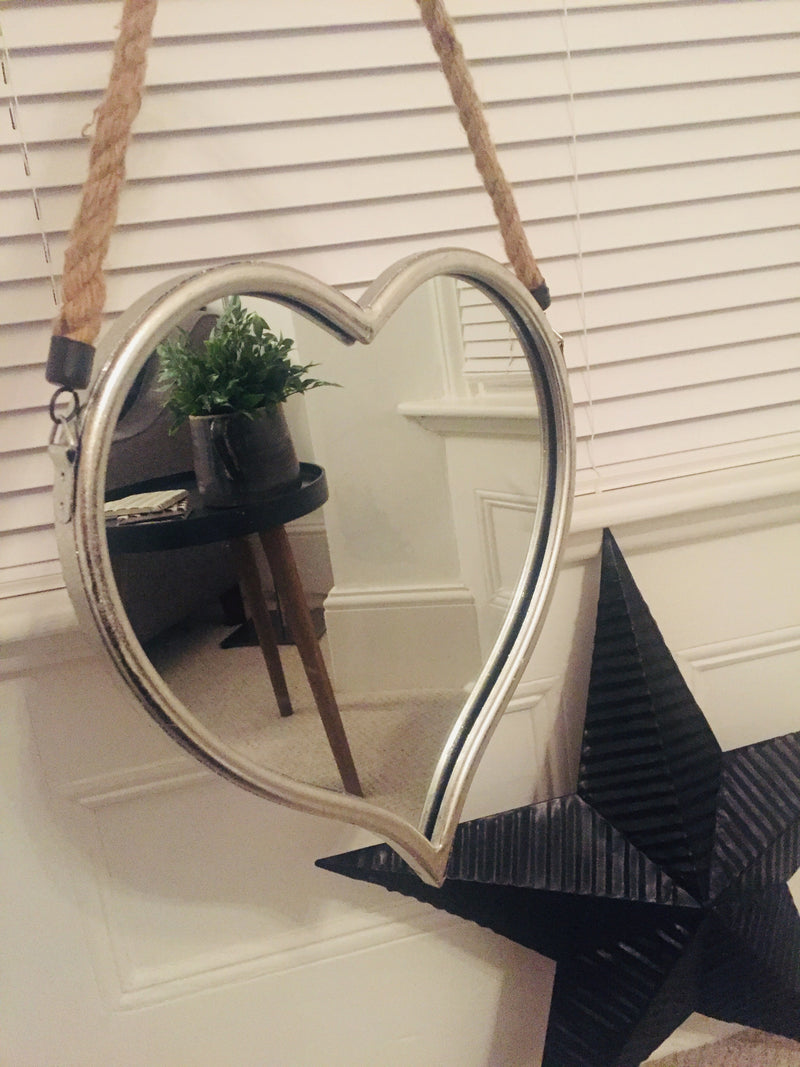 Large silver heart mirror on rope
