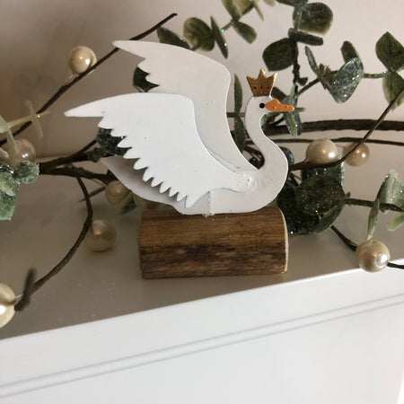 Swan with crown on log