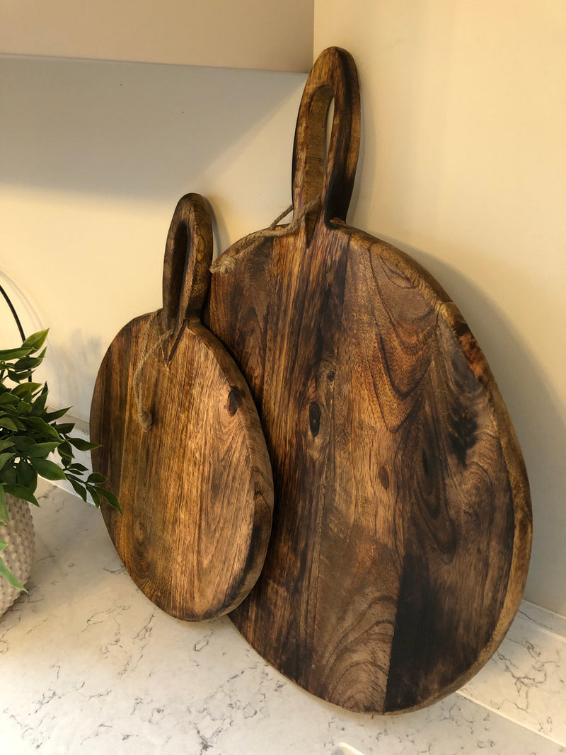 Large round chunky wood chopping board