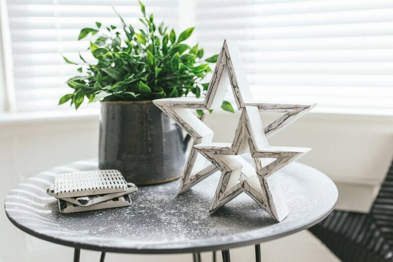 Large hanging white star with heart cut out