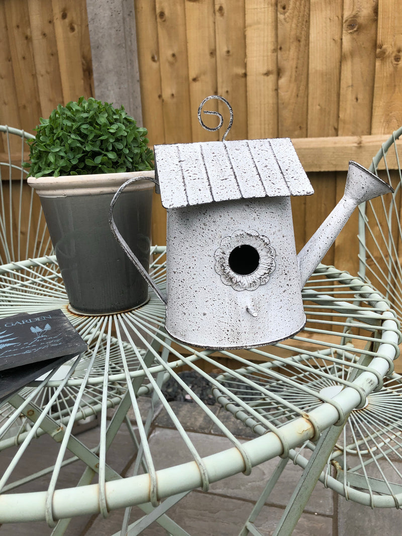 Grey metal bird house