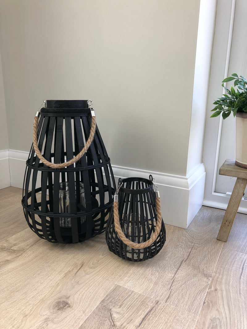 Large black wicker lantern with rope handle