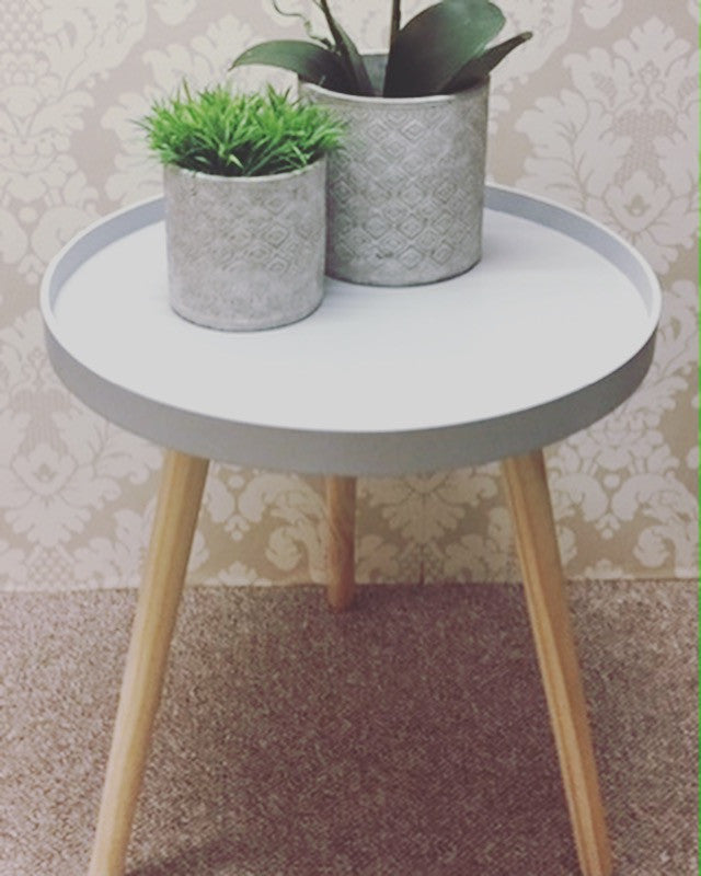 Pale grey simple modern round tripod table