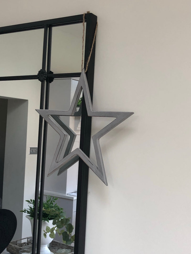 Large grey cut out star