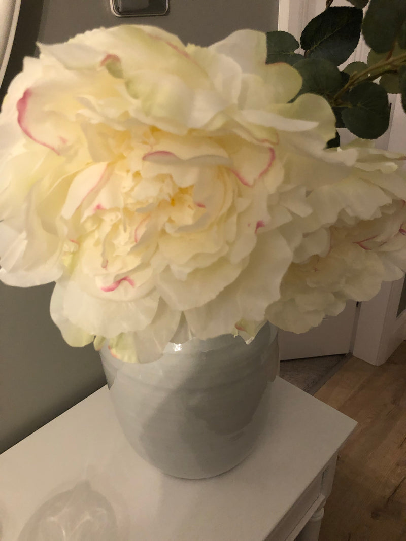 White peony spray with leaves