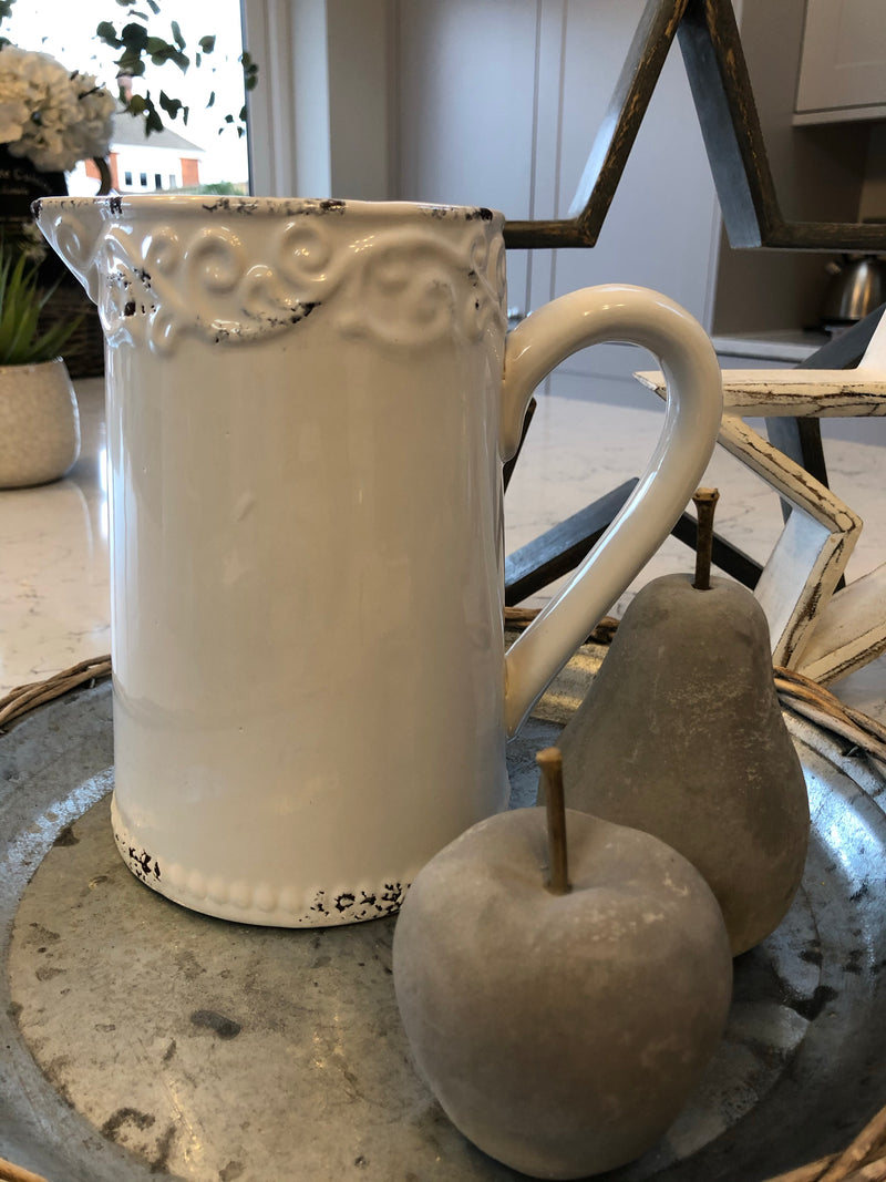 White ceramic jug with embossed top