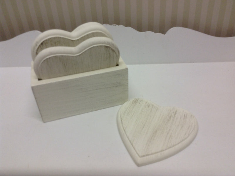 Set of 4 wooden heart coasters in holder