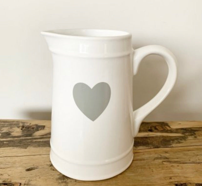 White ceramic jug with heart