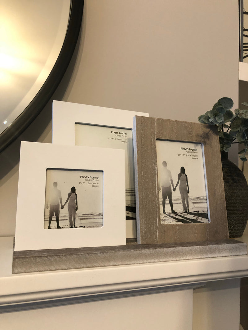 Rustic trio of frames on tray