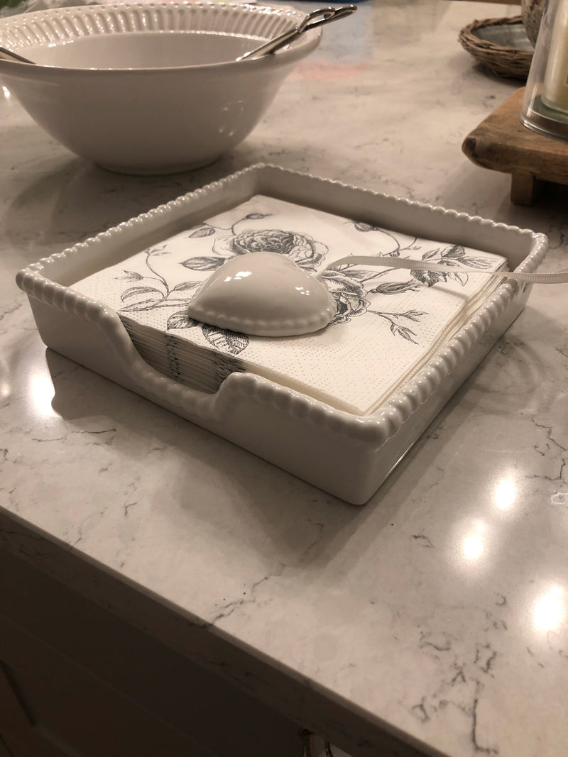White ceramic napkin holder with weight