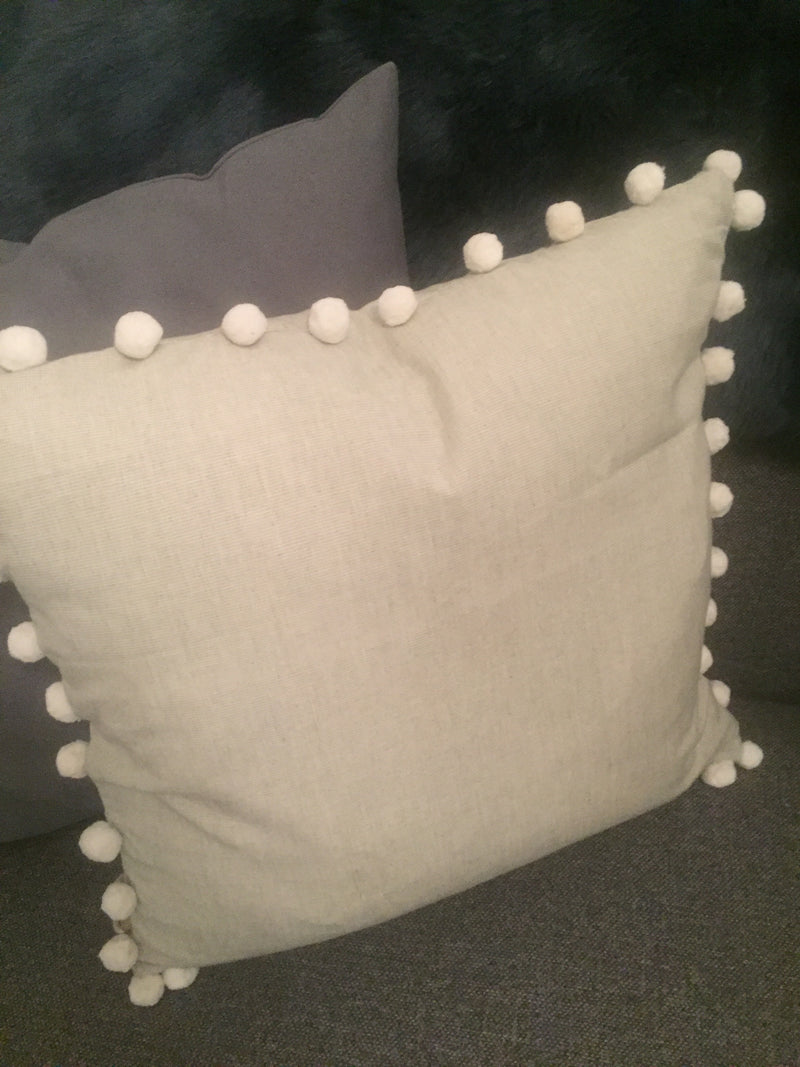 Pale grey pompom edge cushion