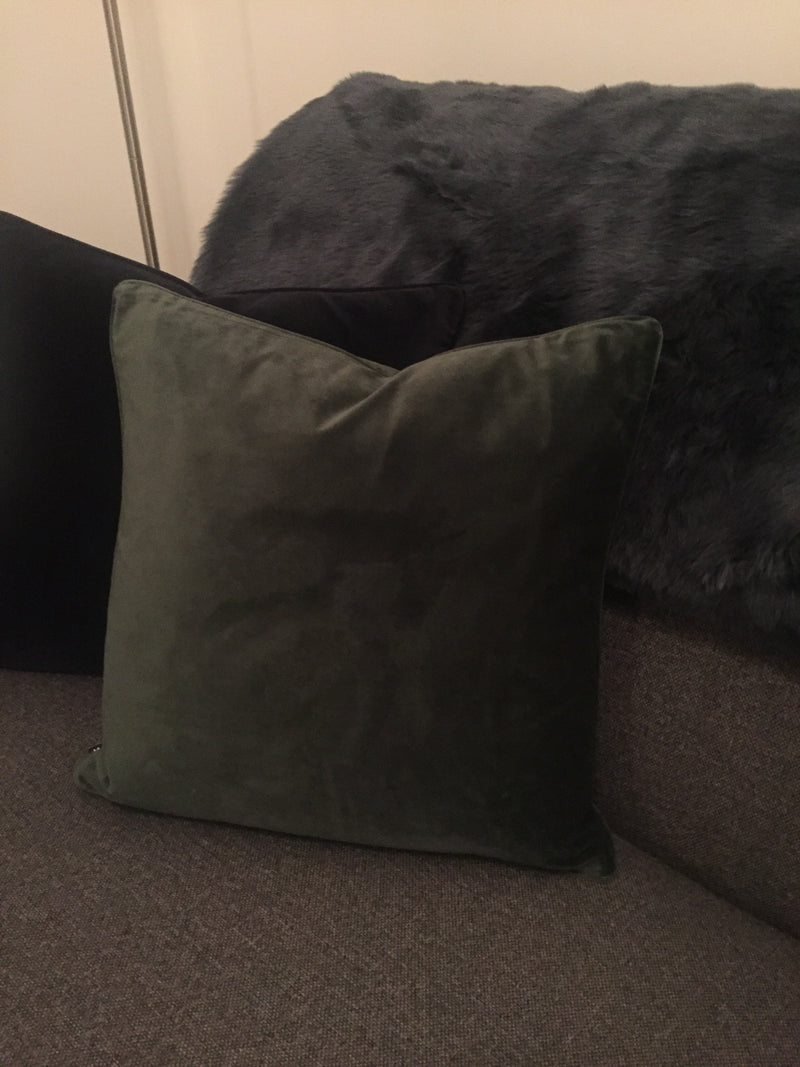 Bottle green velvet cushion