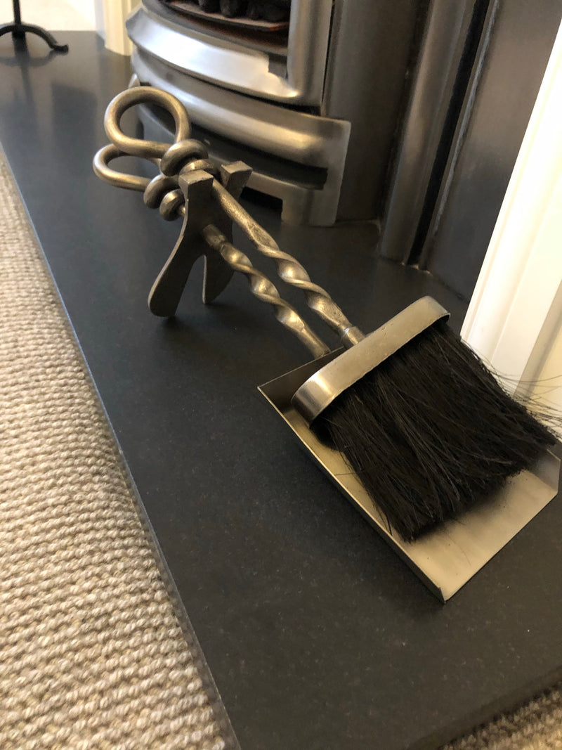 Silver hearth tidy with loop handle