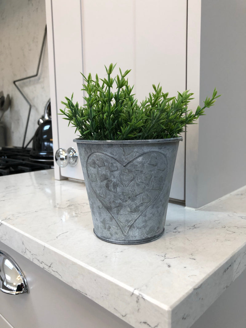 Metal planter with embossed heart