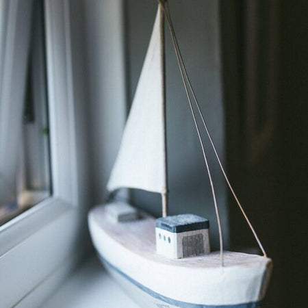 Rustic boat with Linen sail
