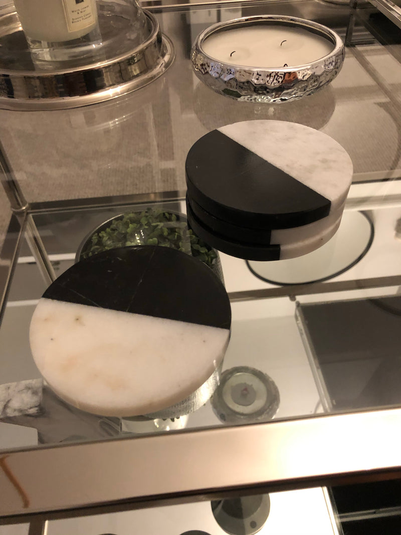 Set of four black and white marble coasters
