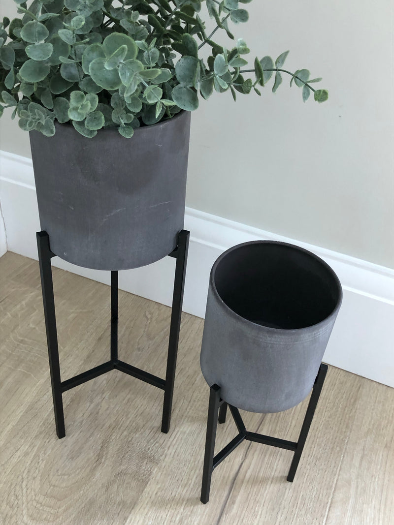 Set of two concrete finish planters on stand