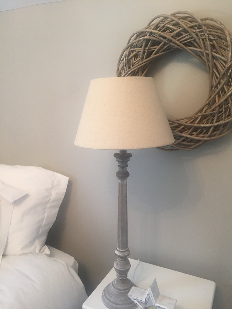 Tall washed wood lamp with linen shade