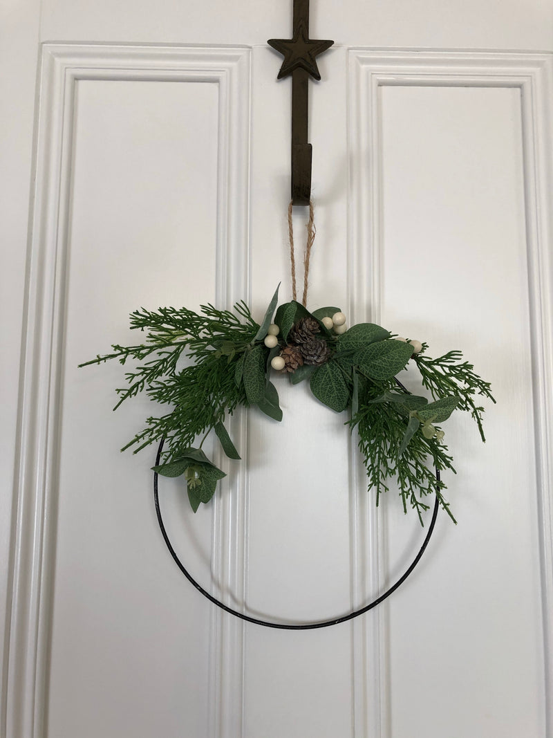 Half ring wreath with pine cone