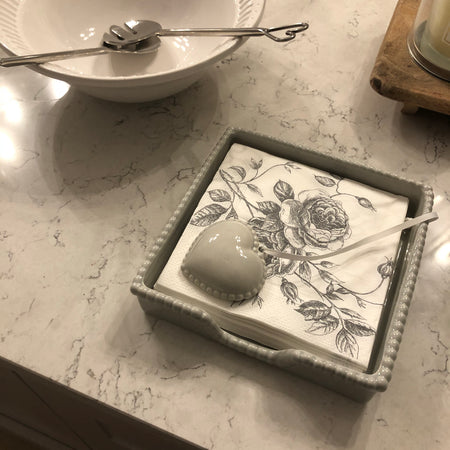Grey ceramic napkin holder with weight