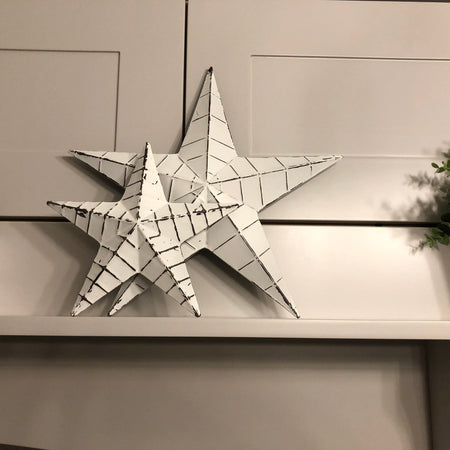 Small off white lined metal barn star