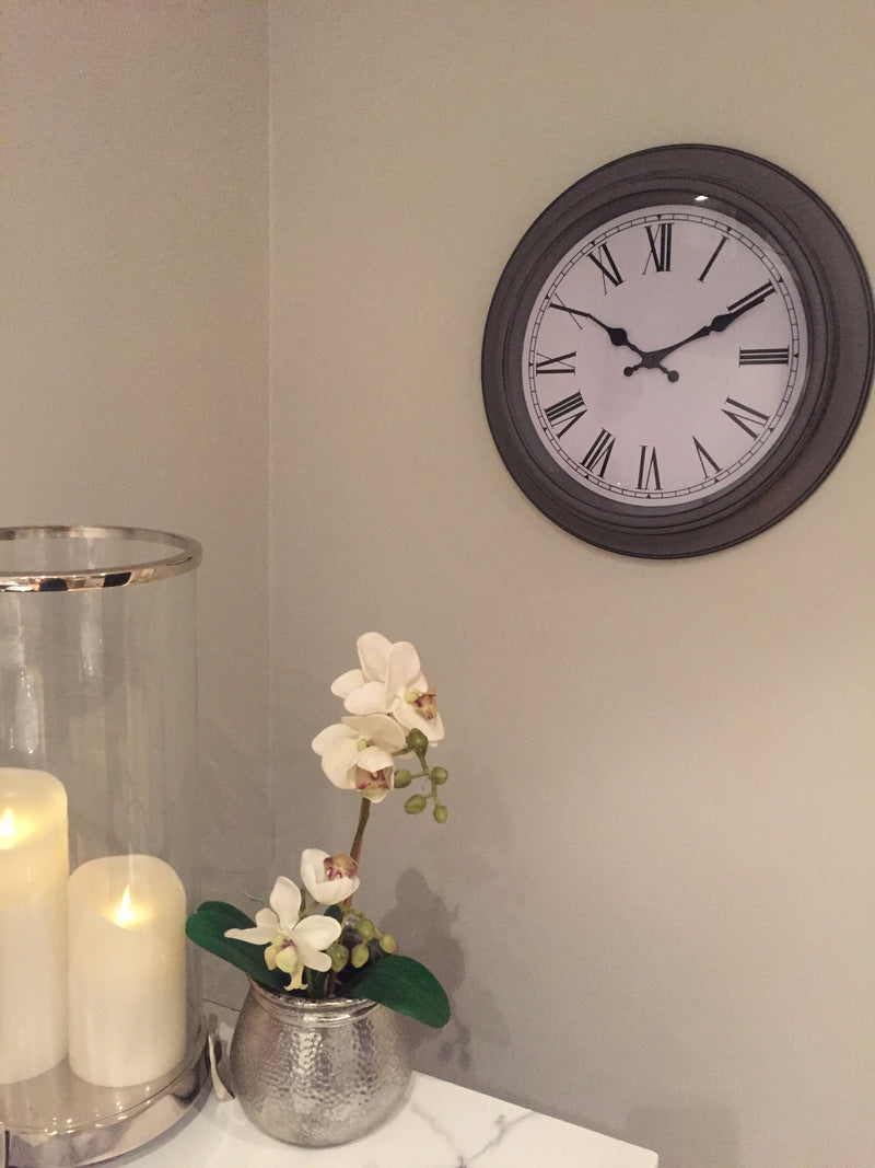 Grey round wall clock