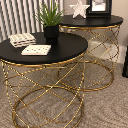 Medium gold side table with black top