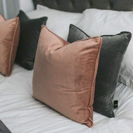 Putty pink velvet piped cushion