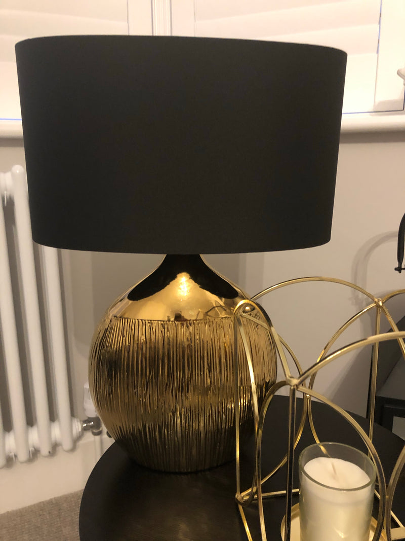 Gold etched ceramic table lamp with black shade