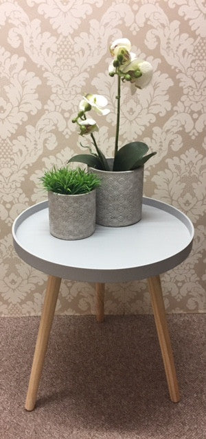 Pale grey modern round table