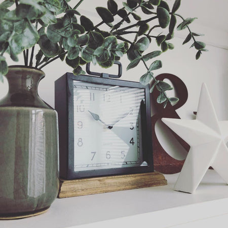 Black wooden based metal clock