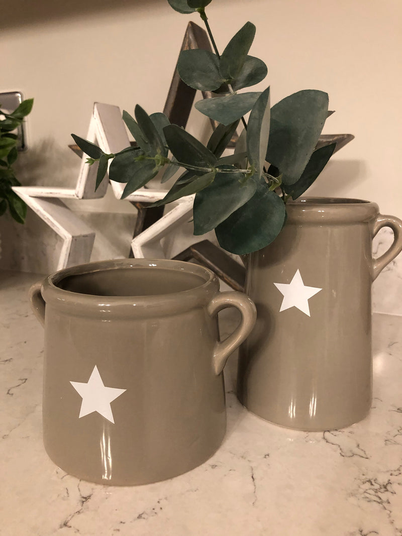 Small grey handled ceramic pot with white star
