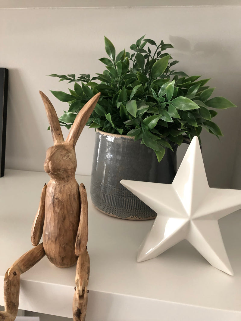 Brown jointed rabbit shelf sitter