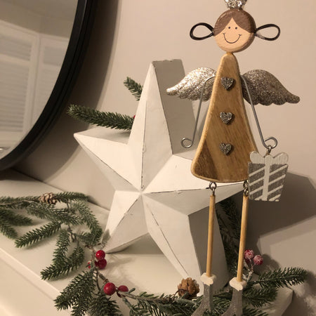 Long wooden angel with dangly legs