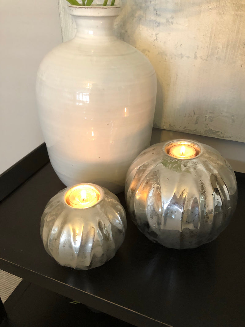 Pair of silver spherical round candle holders