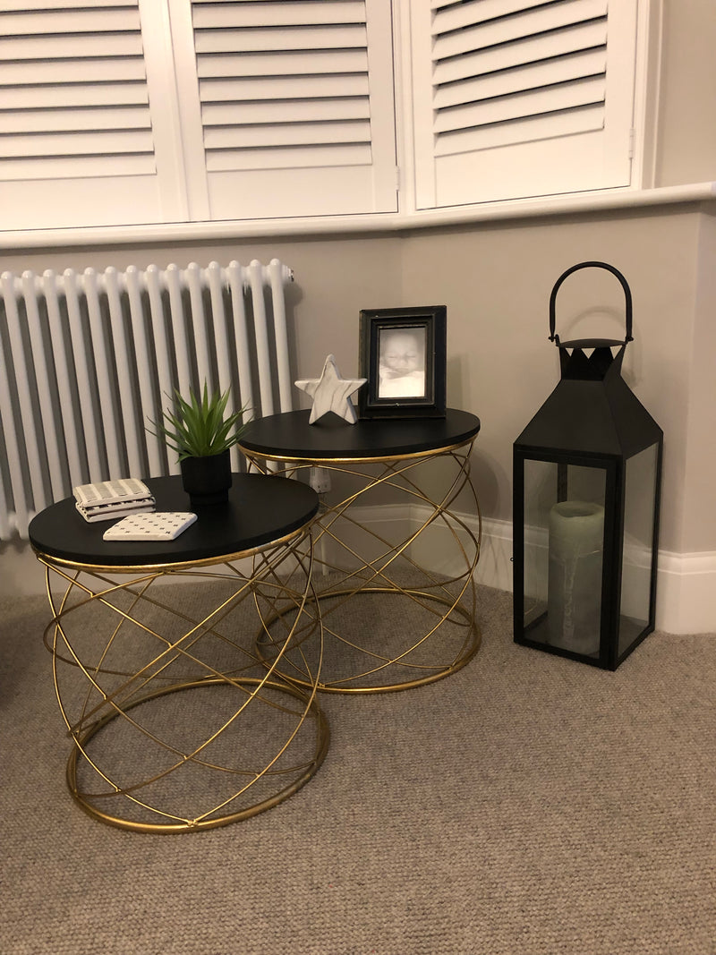 Large gold side table with black top