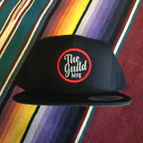 THE GUILD CIRCLE EMBROIDERED SNAP BACK CAP