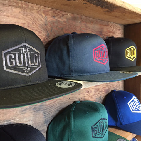 THE GUILD EMBROIDERED SNAP BACK CAP