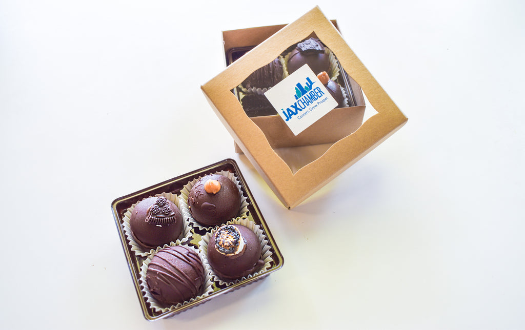 Truffles with box with Jax Chamber logo