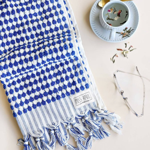 Navy and white pom pom hand towel by Miss April
