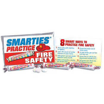 Clear plastic treat bag of 3 rolls or Smarties candy and 2 sided printed card of fire safety tips