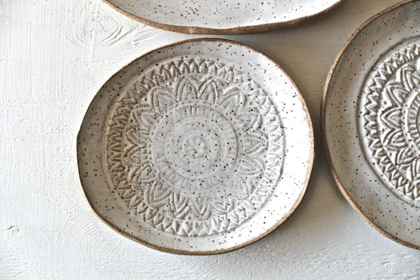 Set Of 4 Hand shaped Pottery Plates in Glossy White Speckled