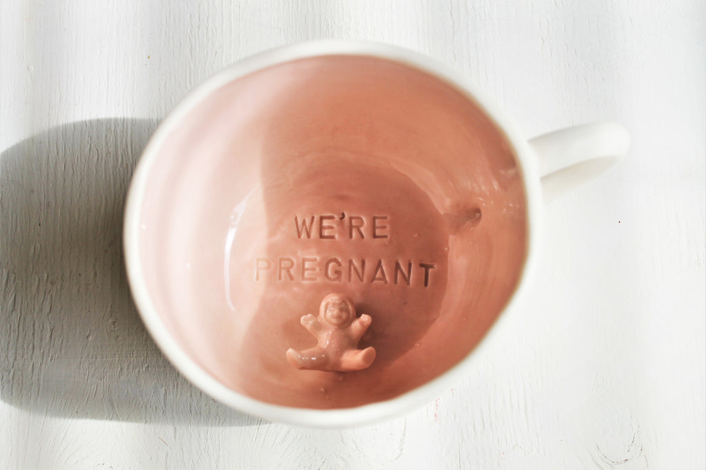 "Cappucino cup ""We're pregnant"""